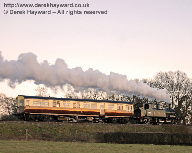 The GWR Auto train steams south from Horsted Keynes at dusk. 17.02.2008