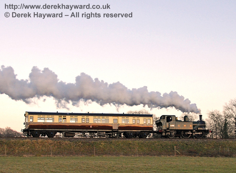 The setting sun just catches the coach as the Auto train steams south from Horsted Keynes. 17.02.2008