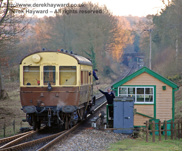 The GWR Auto train collects the single line token as it leaves Kingscote for Sheffield Park. 09.02.2008