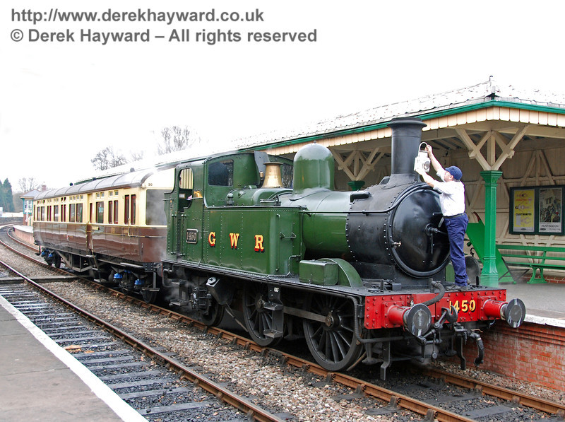 A member of the crew attaches the lamp to 1450 at Kingscote, prior to leaving. Branch Line Weekend 24.02.2008