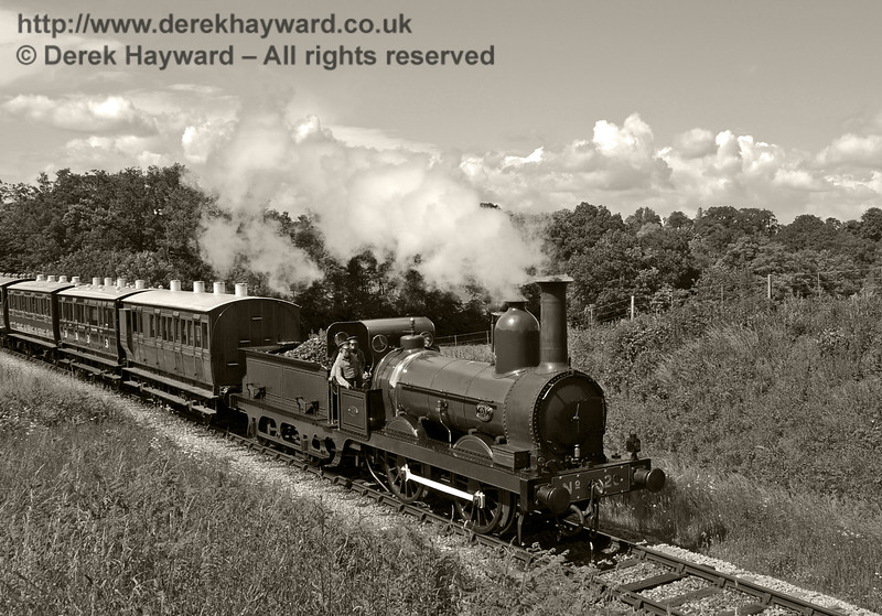 Furness Railway No.20 steams through Rock Cutting with the empty stock from a private filming charter.  19.06.2012  5188/BW