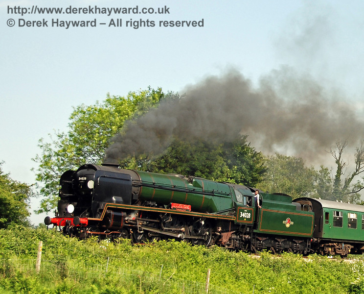 34028 Eddystone steams north from Sheffield Park.   02.06.2007