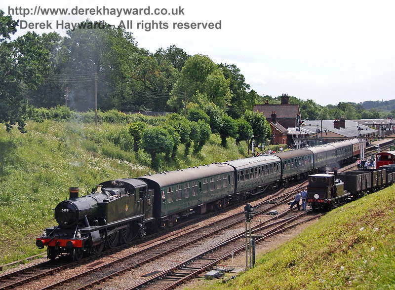 5199 heads north from Horsted Keynes as 672 Fenchurch shunts some goods wagons in the yard.  22.06.2008