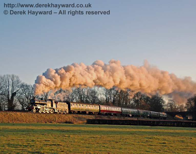 As the low winter sun sinks below the horizon it gives the train a golden glow. 53809 climbs towards Horsted Keynes with a Santa Special. 07.12.2008