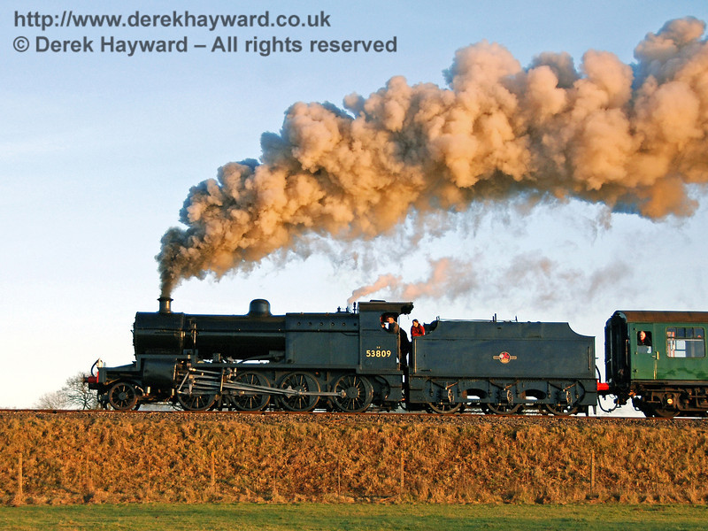 If you get the angles right at Horsted Keynes the evening sun can produce some pleasing colours. 53809 steams north towards the station. 07.12.2008