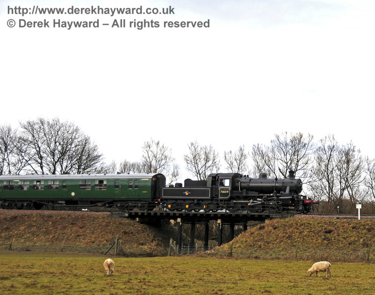 78019 crosses Poleay Bridge with a southbound service. 21.02.2010