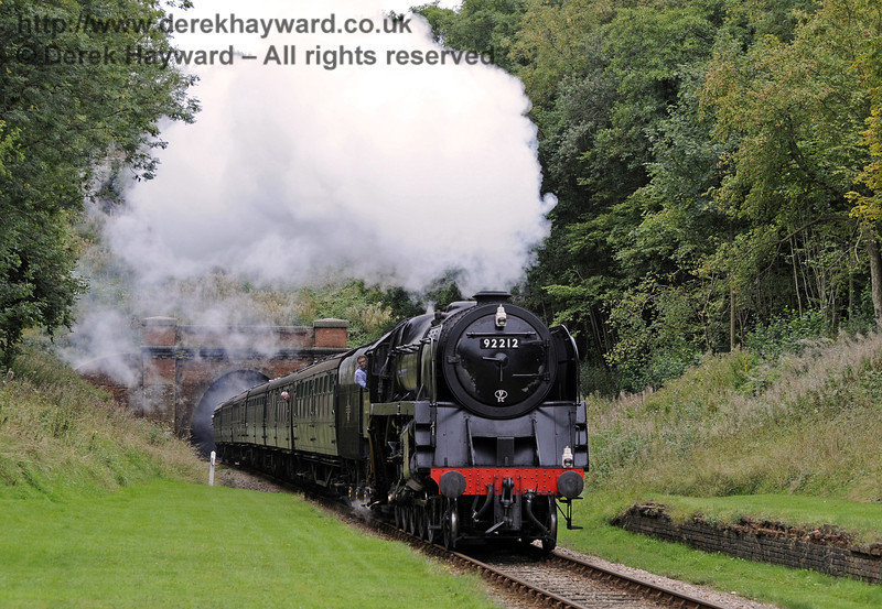 92212 steams through the site of the former West Hoathly Station.  22.09.2013  8062