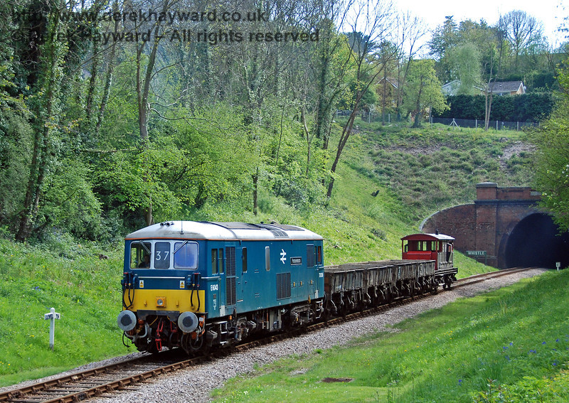 Inert spoil from the southern end of the tip was removed by rail to Horsted Keynes, and (as part of the historical record) this collection includes some pictures of the spoil trains in action. 73136 emerges from West Hoathly tunnel with a spoil train.  29.04.2009