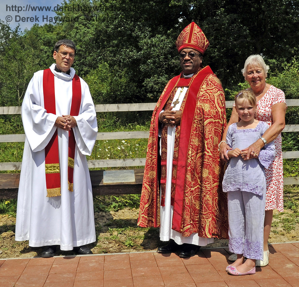 The clergy pose by the main memorial plaque accompanied by Mrs Eastland and her granddaughter.  03.07.2011   2191