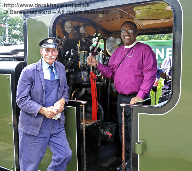 Following the dedication of the Memorial Garden, The Right Revd Cornell Jerome Moss (Bishop of Guyana) takes the controls of B473 under the supervision of Clive Groome.  Horsted Keynes 03.07.2011  2194