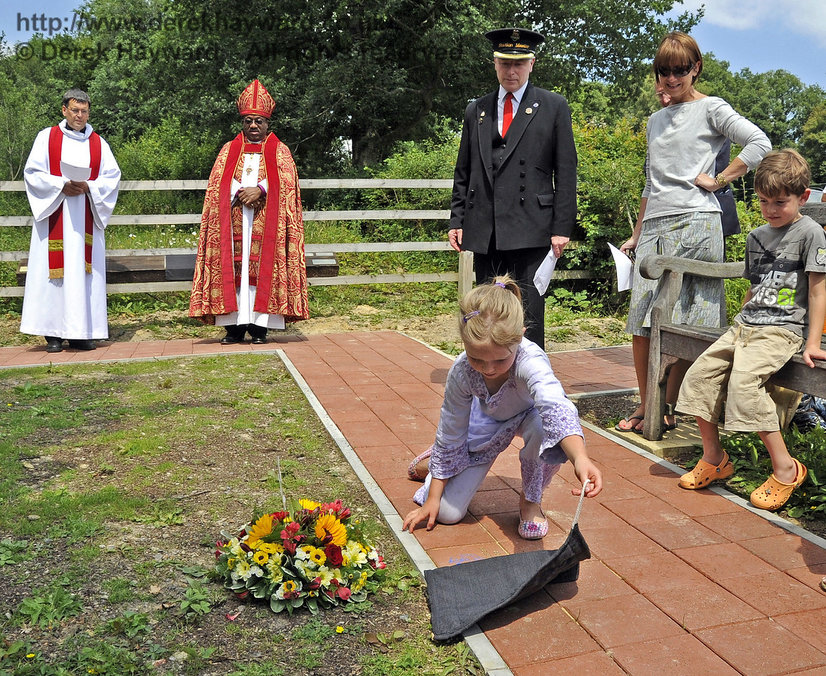 An engraved paving block is unveiled by Martin Eastland's granddaughter whilst Father John Twistleton (Rector of St. Giles' Church, Horsted Keynes, and the Railway's chaplain), The Right Revd Cornell Jerome Moss (Bishop of Guyana), BRPS chairman, Roy Watts, and other family members look on.  03.07.2011   2152