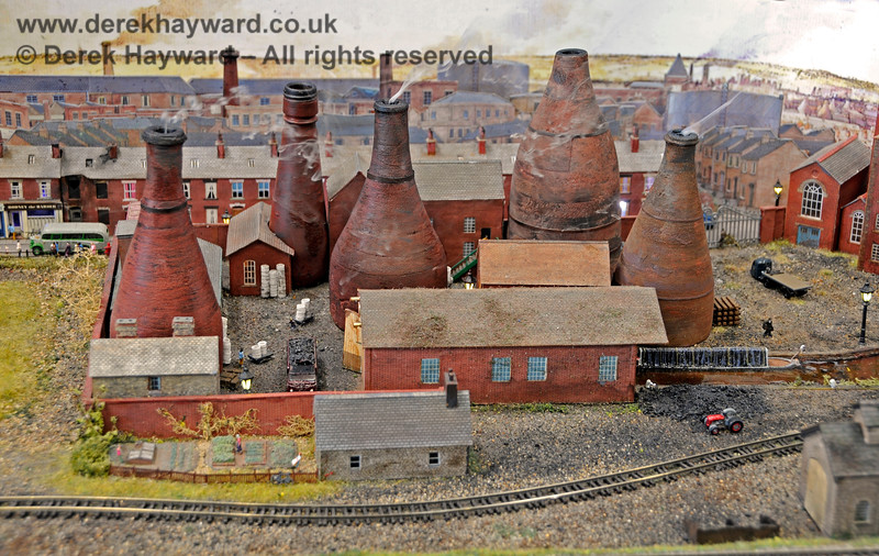 Sometimes the quality of the model speaks for itself and the circulating model trains become less important.  Smoke issues from the kilns in this industrial scene...  Model Railway Weekend, Sheffield Park, 29.06.2019 19551