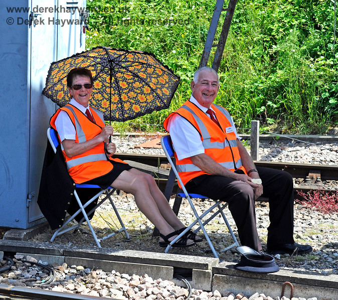 Our hard-working foot crossing supervisors, Joyce and Merv, were feeling the 30 degree heat in their rather exposed position. Model Railway Weekend, Horsted Keynes, 29.06.2019 17192