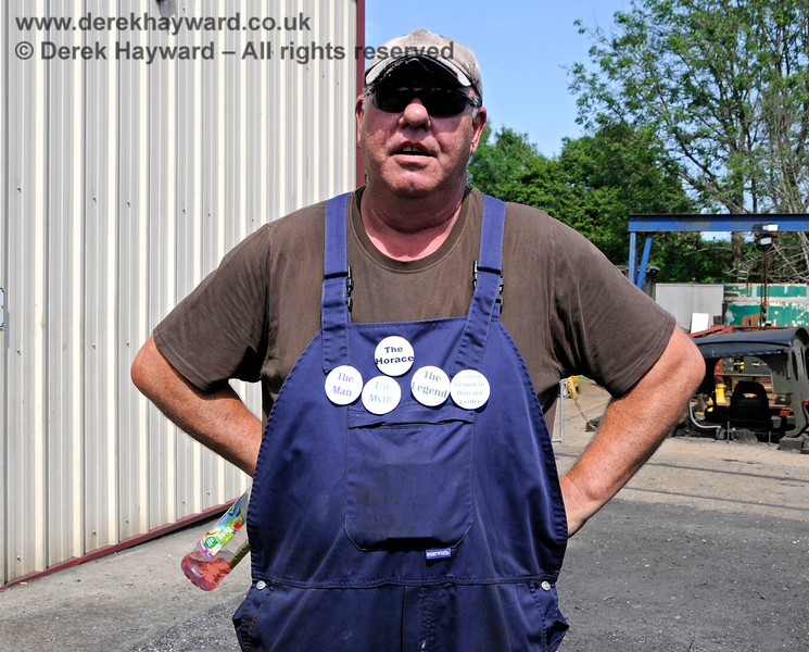 "This man is a legend.  I know that because he has a badge saying so. If you have a working steam engine at the front of your train Locomotive Works Supervisor Andy Sabin, aka ""Horace"", has had something to do with it.  Model Railway Weekend, Sheffield Park, 29.06.2019 19570"
