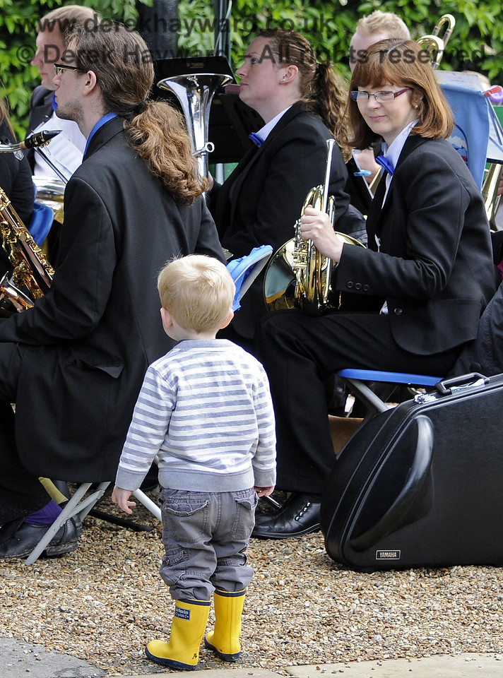 A young enthusiast watches the Bluebell Railway Band at Horsted Keynes.  24.06.2012  8180