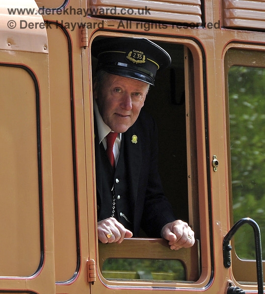 The Guard looks out from 1520 as the train approaches Horsted Keynes.  24.06.2012  5468