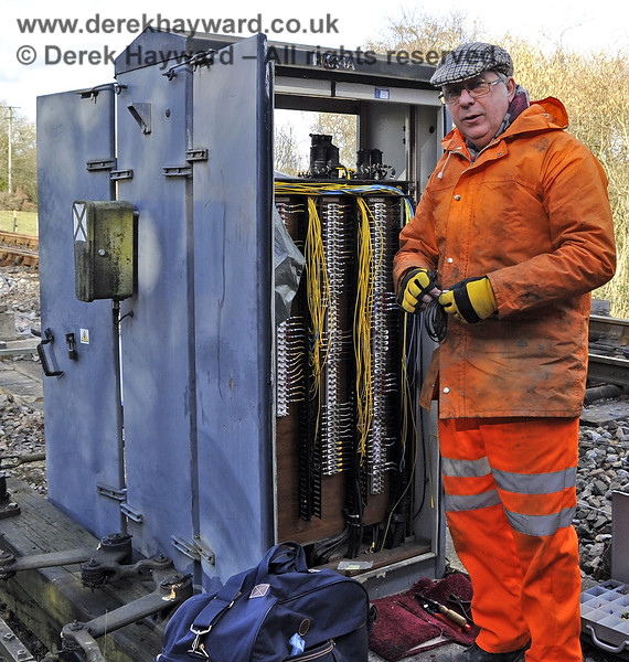 S&T undertake some of the largely unseen preparation work for the northern extension to East Grinstead outside Kingscote signal box in rather inclement weather.  These chaps deserve our unreserved gratitude.  19.02.2012  3577