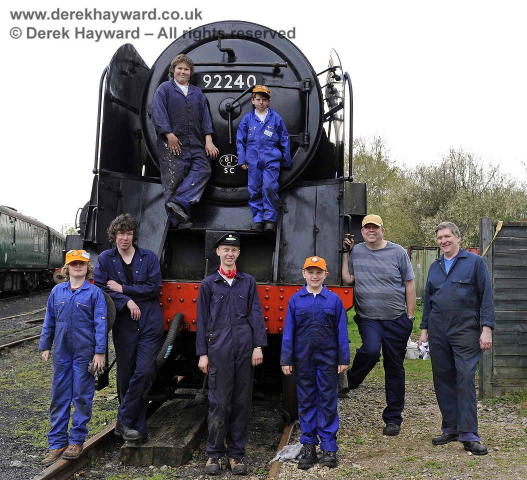 "Members of the 9F Club pose with ""their"" engine, 9F 92240 at Horsted Keynes.  16.04.2011  0832"