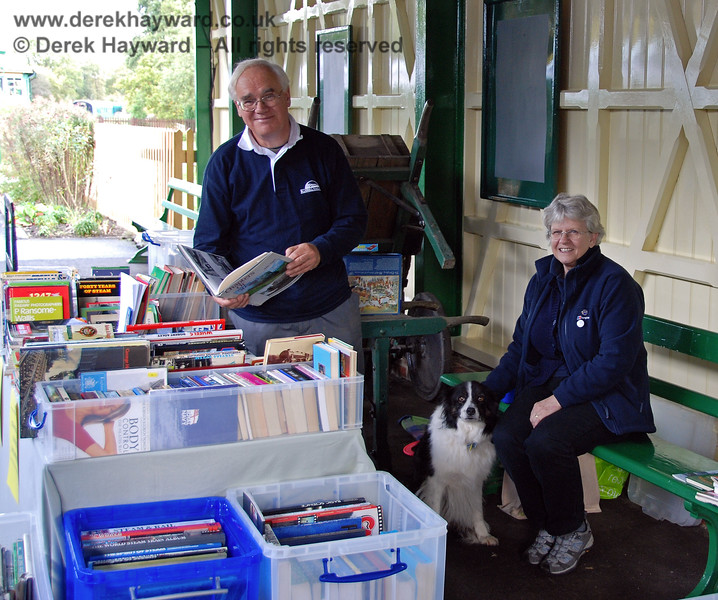John and Mary Sisley running the book stall at Kingscote, assisted by their dog Meg.  The stall was raising money for the Northern Extension.  23.10.2009