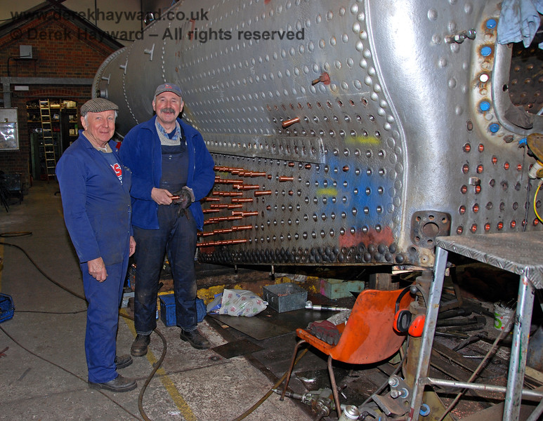 Members of the Workshops team at Sheffield Park inserting copper stays into the boiler from 847.  24.01.2010