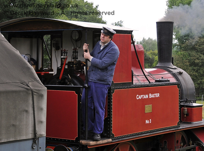 A member of the crew on board Captain Baxter carefully shunts a goods train at Kingscote.  15.08.2010  3896