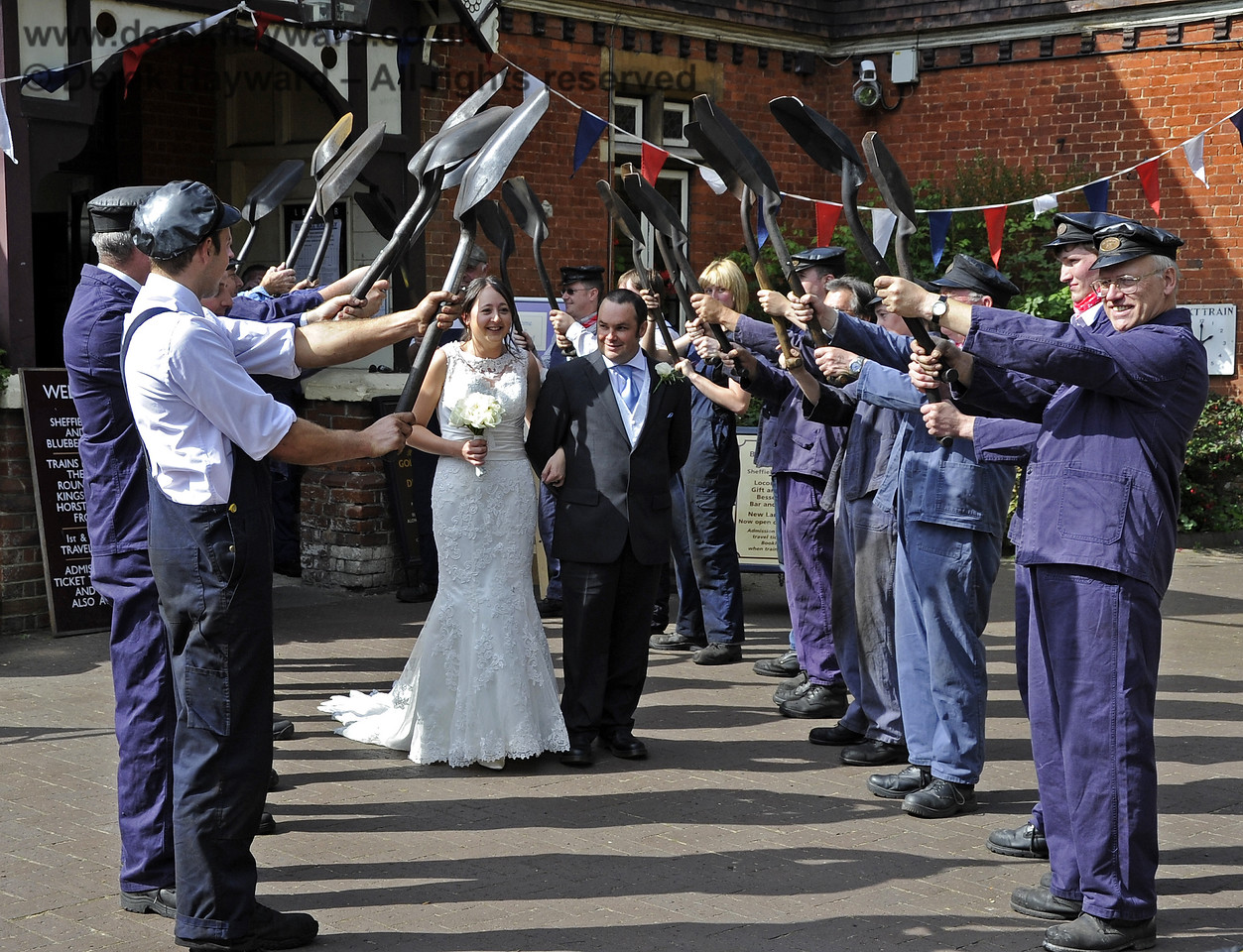 Members of the Locomotive Department form an impressive Guard of Honour for a staff wedding at Sheffield Park.  15.09.2012  5677
