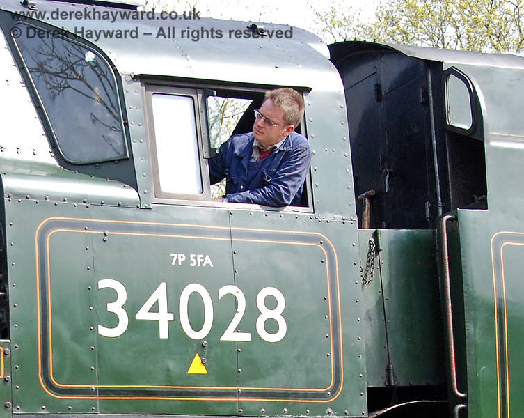 The driver on duty on 34028 Eddystone as it approaches Kingscote.  14.04.2007