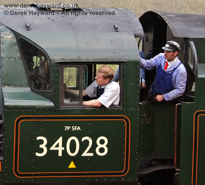 Driver Mike Lee in charge of 34028 Eddystone, on the final day of his driving test, whilst the fireman gets ready to surrender the single line token.  Kingscote 09.04.2007.  At the time Mike was also the Fireman's roster clerk and general Secretary of the Bulleid Society.