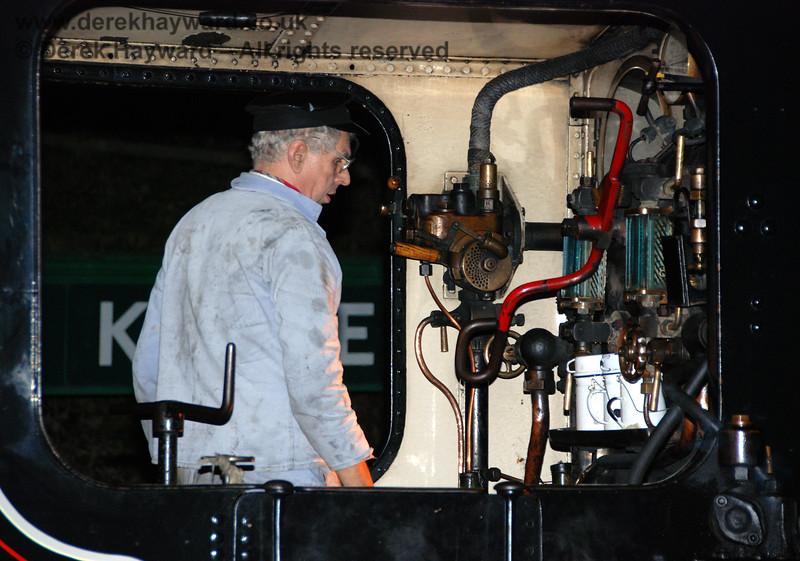 Mike Roberts on board 32473 after dark at Horsted Keynes.  21.01.2007