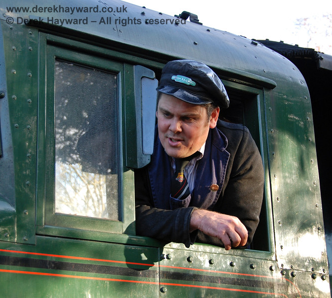 A member of the crew on 34059 Sir Archibald Sinclair outside Kingscote.  06.12.2009