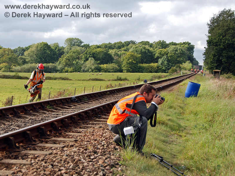 Another photographer goes about his business on Freshfield Bank, although the trains generally run on the track behind him.  Meanwhile Jon Bowers is busy with a strimmer whilst the rest of the PWay team head north before Jon notices.... 23.09.2007