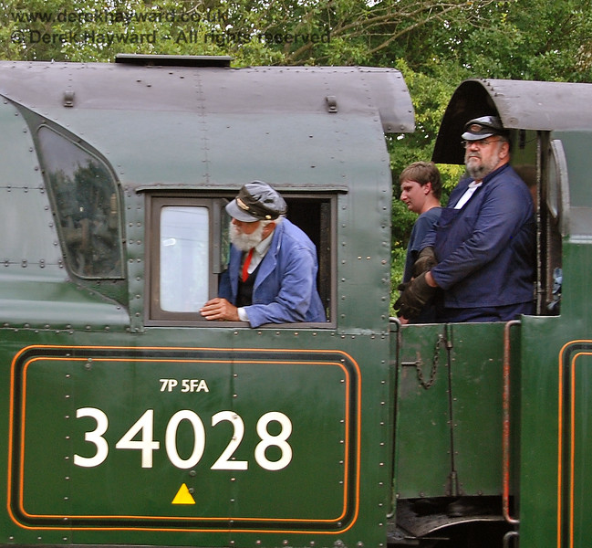 The crew on board 34028 Eddystone as it approaches Kingscote.  Standing behind the driver is the late Phil Stoneman.  12.08.2007