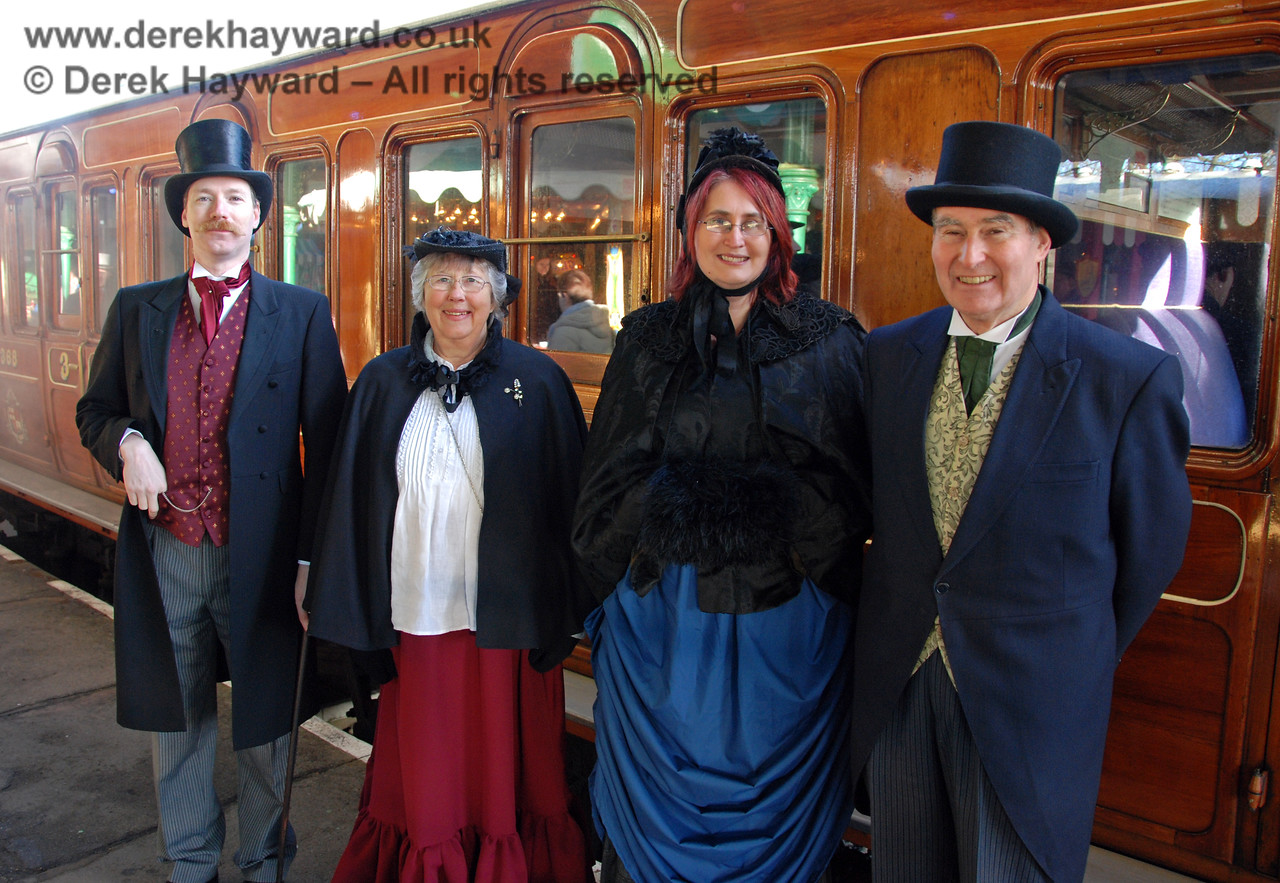Smartly dressed members of the Victorian Christmas team pose at Horsted Keynes.  02.01.2010
