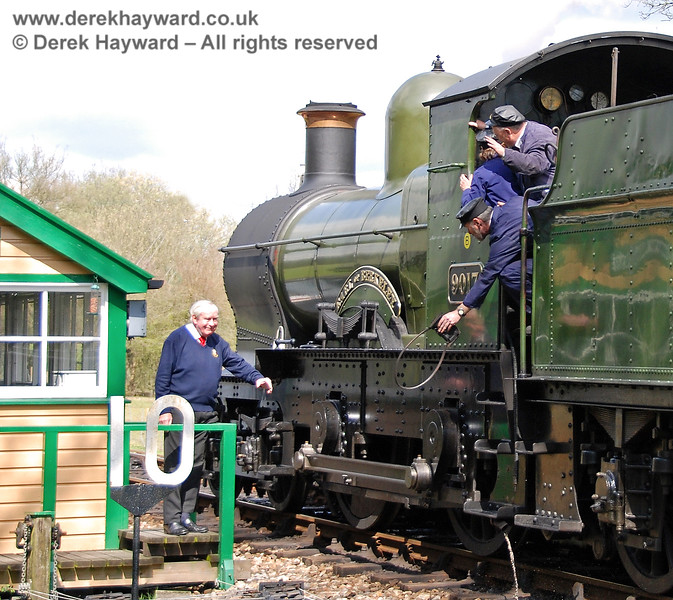 It is not clear what is happening on the footplate, but the signalman at Kingscote stands ready to receive the token!  09.04.2008