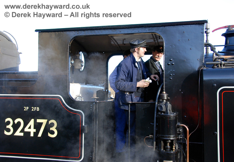 The crew on the footplate of 32473 at Kingscote, with Clive Groome (in the background) driving.  14.01.2007