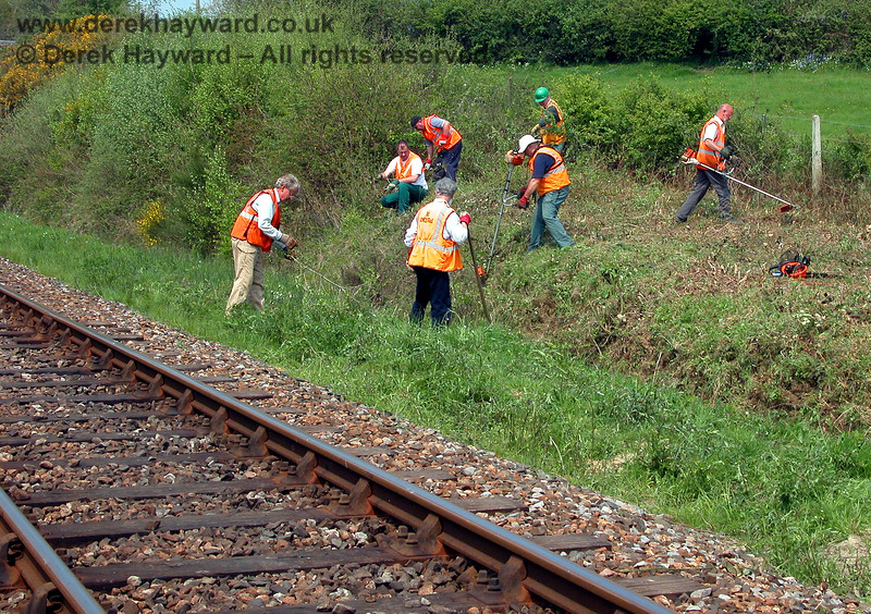 The lineside clearance team at work adjacent to Medhurst Farm.  10.05.2006