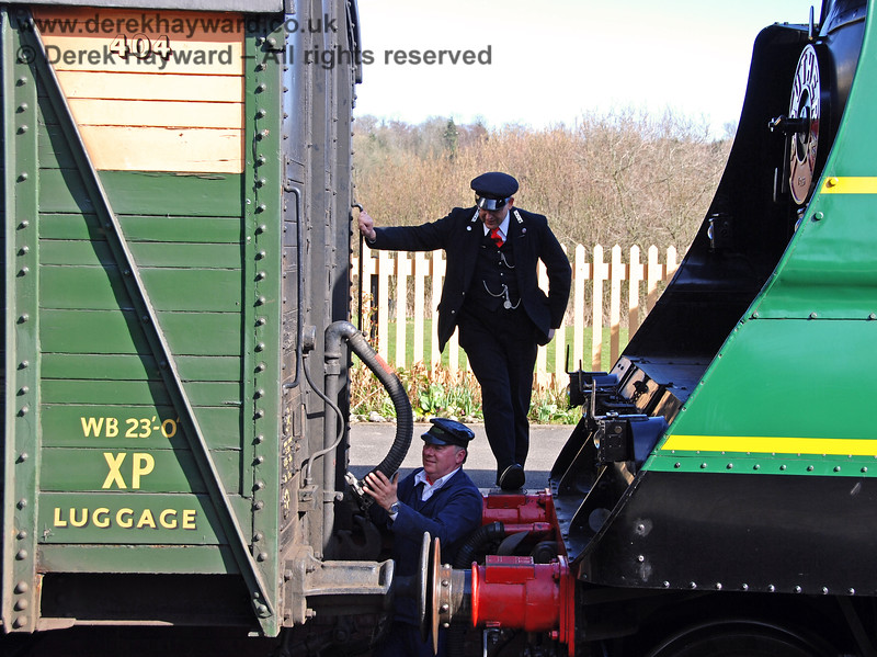 Staff at Kingscote pass the time of day as 21C123 Blackmoor Vale is coupled.  11.03.2007
