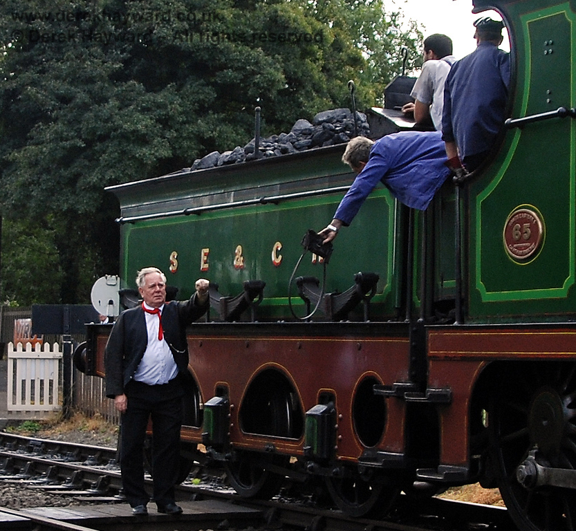 The signalman receives the single line token at Sheffield Park.  23.09.2007