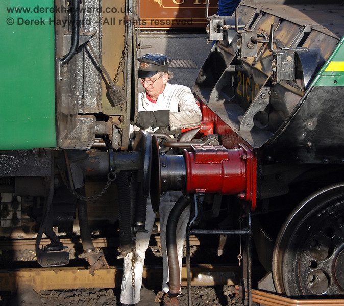 A member of the crew uncouples 21C123 Blackmoor Vale.  Sheffield Park 10.03.2007
