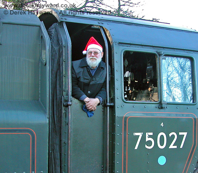 Entering into the spirit of Christmas on the footplate of 75027.  Sheffield Park 03.12.2006