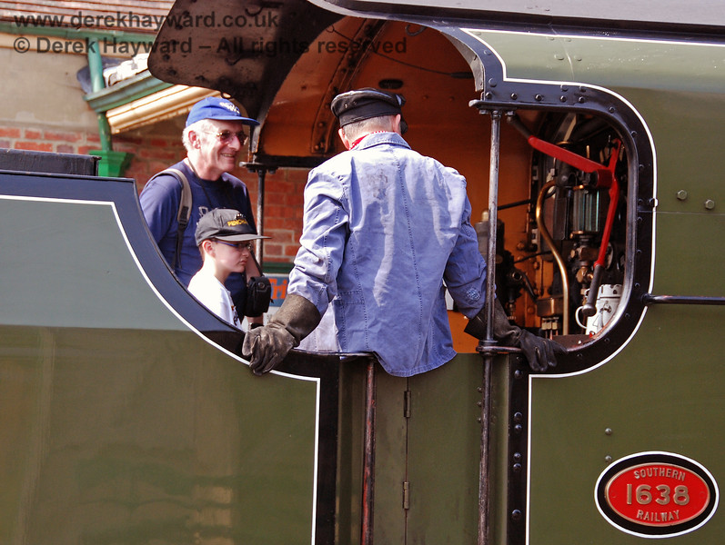 The crew of 1638 entertain visitors to the footplate at Kingscote.  14.04.2007