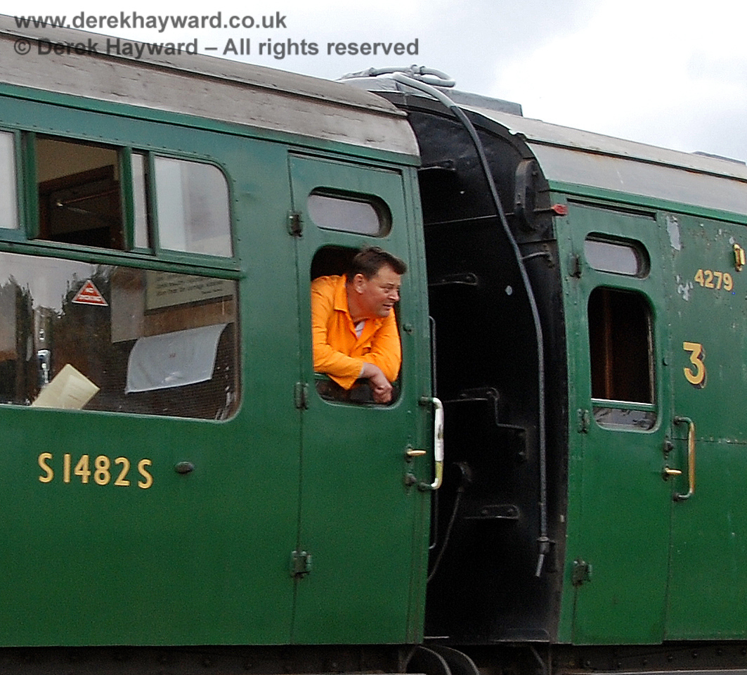 Chris Cooper carefully checks the exterior presentation of the carriages on the way past Ketches Halt.  23.09.2007