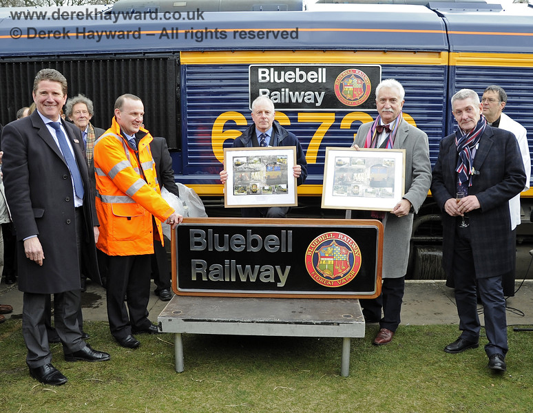 "The naming of GB Railfreight Class 66, 66739, ""Bluebell Railway"" at Horsted Keynes, together with the presentation of a third nameplate for the Museum and commemorative pictures for the BPRS and PLC.  Present are John Smith, Managing Director GBRf; a member of his team (in orange as he was shunting the train); Roy Watts Chairman BRPS; Graham Flight retiring Chairman Bluebell Railway PLC; and Chris White Infrastructure Director.  In the background are (left) Gordon Pettitt and (right) Canon John Twistleton, Chaplain to the Bluebell Railway.  28.03.2013  6396"