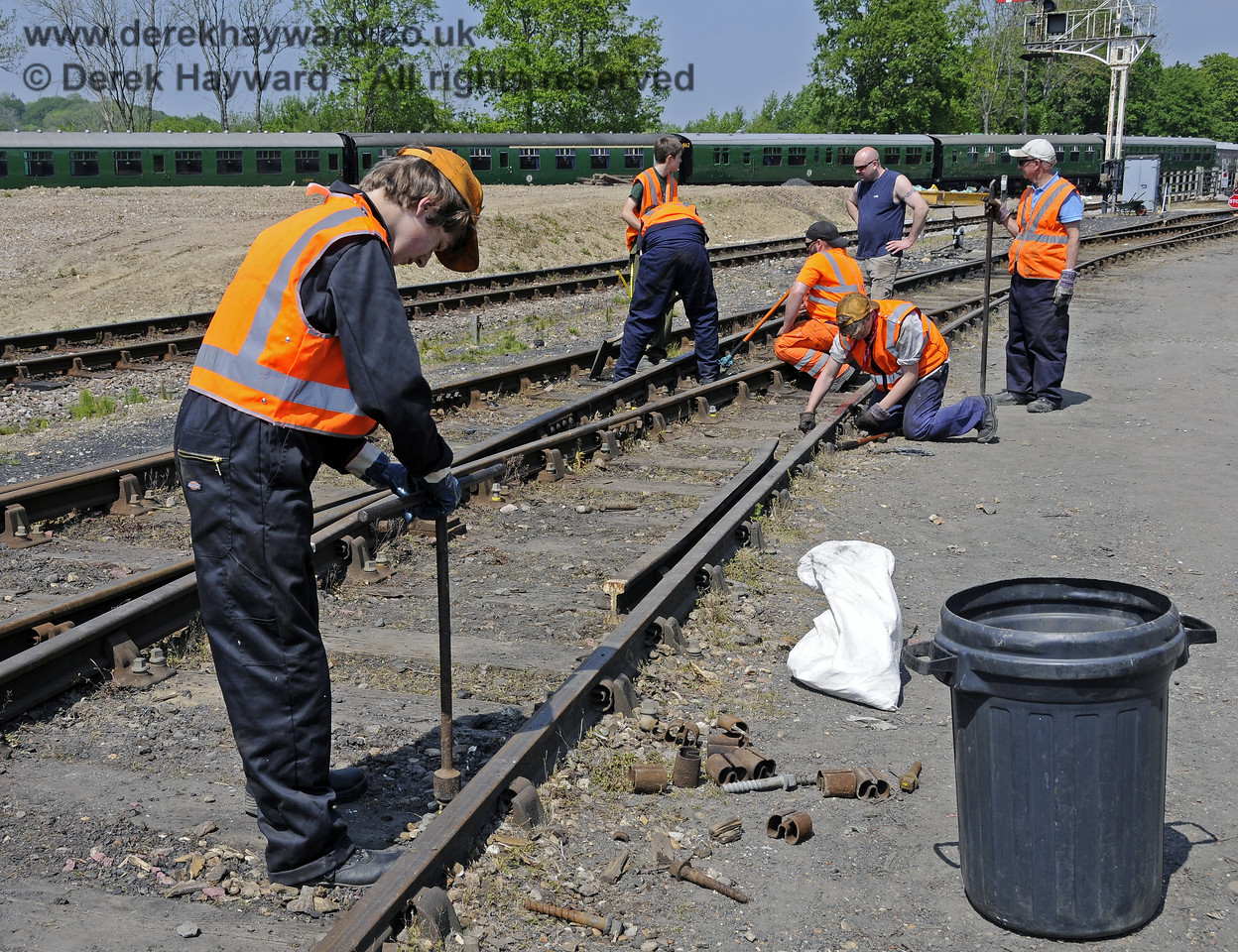 Members of the 9F Club under instruction in the various aspects of PWay work in a blocked section of the Down Yard at Horsted Keynes.  18.05.2014  10538