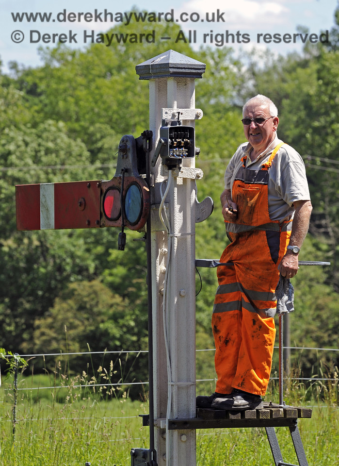 Replacing corroded contact boxes that monitor the position of the signals with new sealed micro-switches.  This work will eventually take place on all signals. Kingscote Advance Starter. 08.06.2014  9510