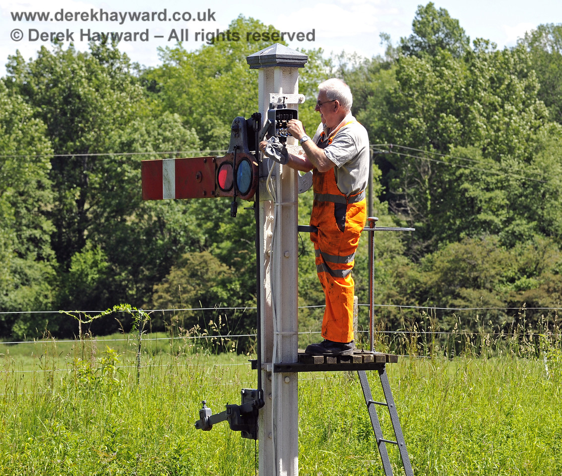 Replacing corroded contact boxes that monitor the position of the signals with new sealed micro-switches.  This work will eventually take place on all signals. Kingscote Advance Starter. 08.06.2014  9506