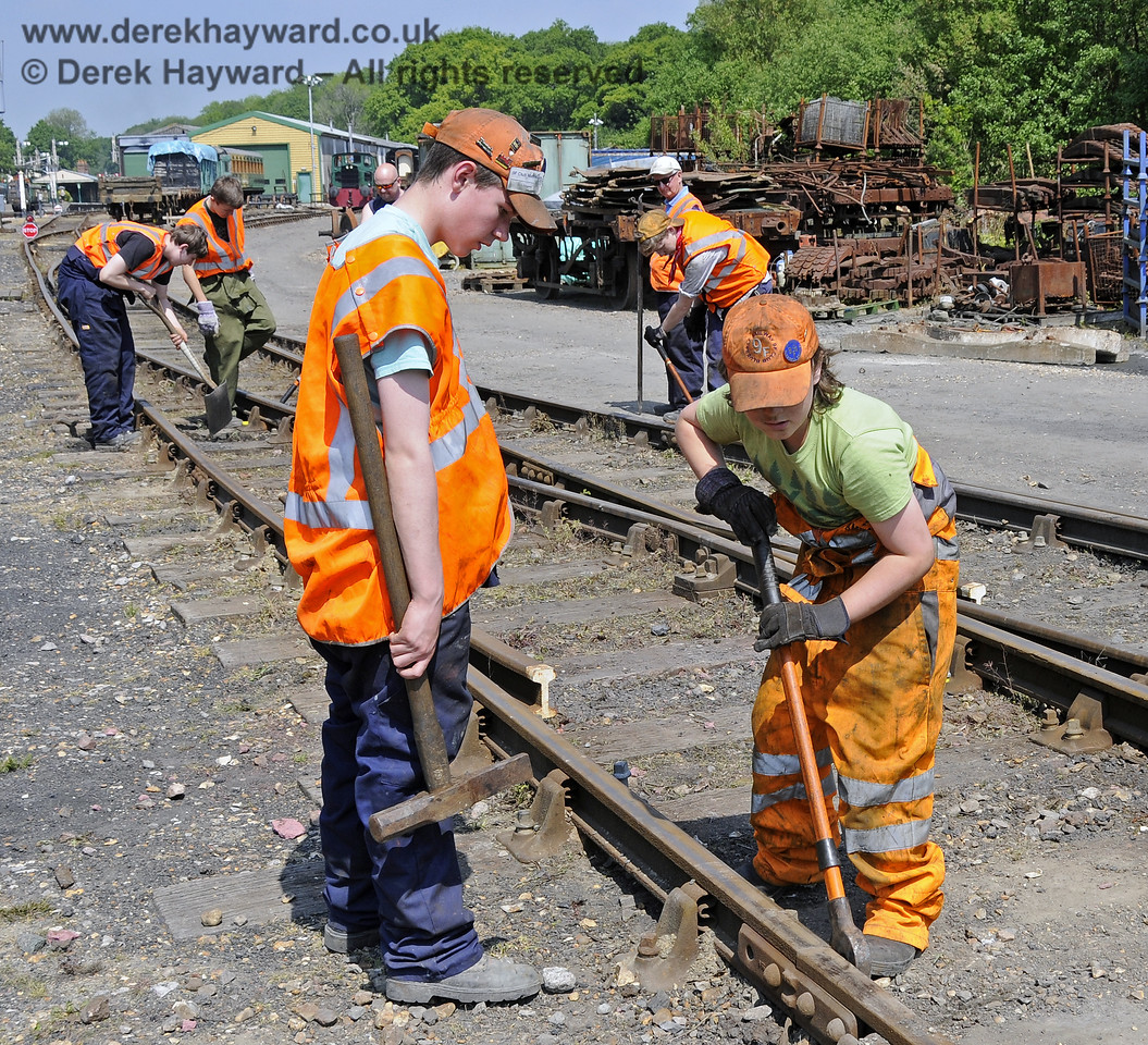 Members of the 9F Club under instruction in the various aspects of PWay work in a blocked section of the Down Yard at Horsted Keynes.  18.05.2014  10537