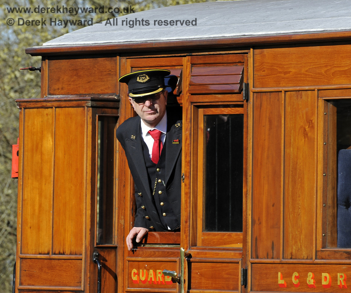 A Guard looking out as the train leaves Kingscote.  16.03.2014  8741