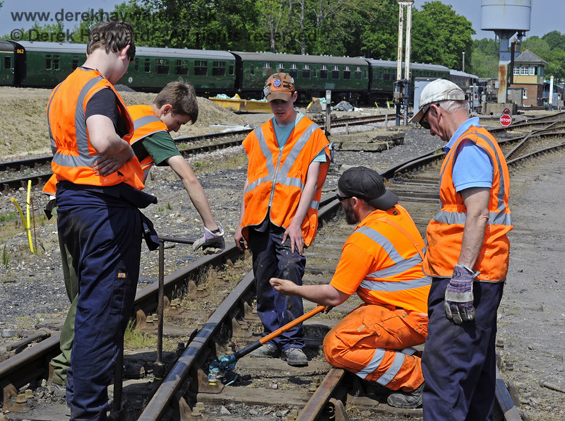 Members of the 9F Club under instruction in the various aspects of PWay work in a blocked section of the Down Yard at Horsted Keynes.  18.05.2014  9365