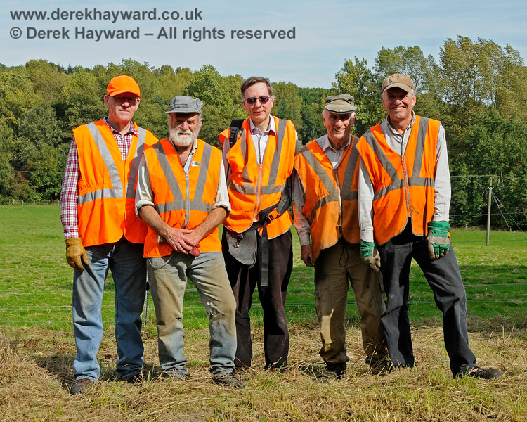 The Friends of Kingscote caught during lineside clearance south of the station.  24.09.2016 16325